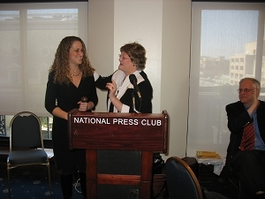 ylvia Smith, center, passes the presidential gavel to Donna Leinwand. Former President Gil Klein is at right.