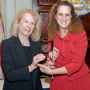 Darlene Shields, left, accepts the top honor for volunteerism from President Donna Leinwand