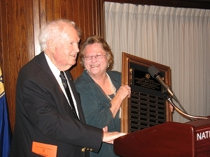 President Sylvia Smith presents John Cosgrove with the first President's Award of Distinction