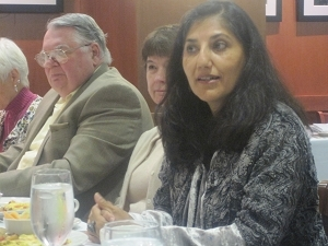 "Arnie Donahue and Lorna Aldrich listen as Maniza Naqvi explains her book, ""A Matter of Detail"""