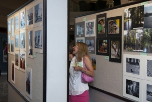 NPC Member Kerry McKenney enjoys the photographs during the September 2, 2010 11th Annual Members' Photography Exhibit.