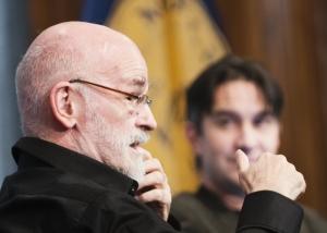 Author Sir Terry Pratchett (foreground)