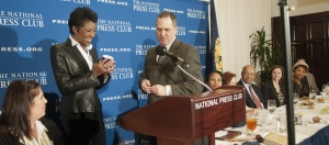 Singer Natalie Cole accepts a National Press Club mug from Club President Mark Hamrick