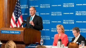 """Cleveland Clinic chief executive Dr. Delos """"Toby"""" Cosgrove addresses health care policy at a July 20 National Press Club luncheon. Club President Theresa Werner and former Secretary of Defense William Cohen joined him at the head table."""