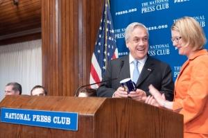 Club President Angela Greiling Keane presents ritual NPC mug to Chilean President Sebastian Pinerat