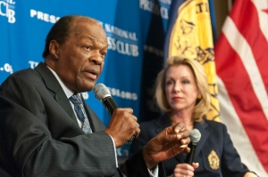 Former Washington, D.C., mayor Marion Barry Jr. answers a question posed by Club member Eleanor Herman (r).