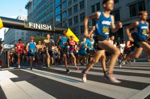 Runners leave the starting line of the National Press Club's Beat the Deadline 5K race, September 6, 2014.