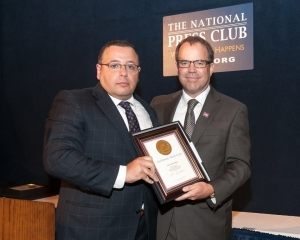 Ali Rezaian (left) accepts the John Aubuchon Press Freedom Award from NPC president John Hughes on behalf of his brother, Jason, who has been jailed in Iran since 2014.