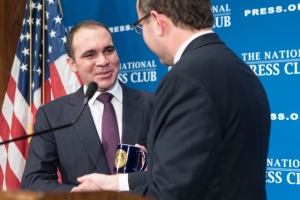 Prince Ali Bin Al Hussein (left) of Jordan receives National Press Club mug from Club President John Hughes following his luncheon address Dec. 4.