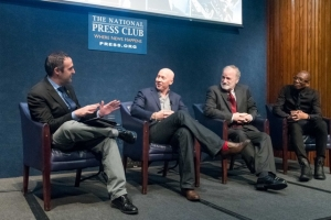 """National Press Club President Thomas Burr (left) moderates a panel discussing the new PBS series, """"Soundbreaking: Stories from the Cutting Edge of Music,"""" which previewed at the Club Nov. 9."""