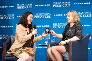National Press Club President Andrea Edney, left, presents a Club mug to Olympic gold medalist Katie Ledecky at a Club Headliners Luncheon on March 26.