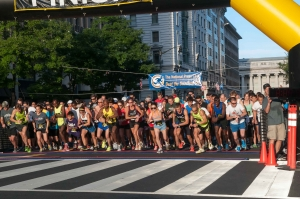 Runners leave the starting line at the National Press Club Beat the Deadline 5K Race, Sept. 7, 2013.