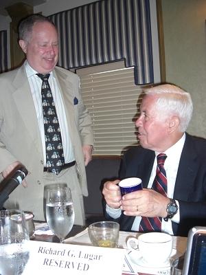 Sen. Richard Lugar receives an NPC mug from International Correspondents Committee chairman Myron Belkind