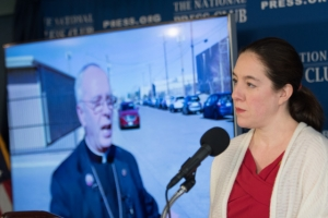 Andrea Edney speaks at a National Press Club news conference protesting the continued detention of Mexican journalist Emilio Guttierrez on Friday, Jan. 19, 2018. Mark Seitz, bishop of the El Paso Catholic diocese, spoke by phone at the event and is pictured left of Snyder Edney.