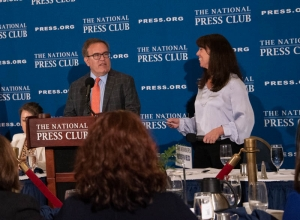 National Press Club Alison Fitzgerald Kodjak reads questions submitted by audience members to Andrew Wheeler, administrator of the Environmental Protection Agency, at a June 3 luncheon.