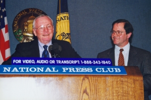 Neil Armstrong, the first man to walk on the moon, responds to a question during his NPC luncheon appearance on Feb. 22, 2000. Sharing the podium is Club President Jack Cushman.
