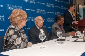 Former NPC president Larry Lipman introduces journalist Simeon Booker (center left) before a National Press Club Book Rap,  April 9, 2013.  Also seated are his wife, Carol McCabe Booker and SiriusXM Radio host Joe Madison.
