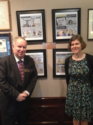 Myron Belkind, president of the National Press Club, poses with this year's Herblock Award winner Jen Sorensen in front of her cartoons now hanging in the NPC's Reliable Source.