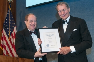 Newsman Charlie Rose accepts the Fourth Estate Award from NPC President Myron Belkind, Sept. 13, 2014.