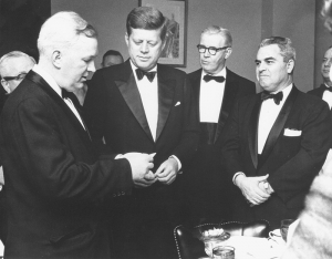 John Cosgrove (far left) presents newly-elected President John F. Kennedy with his NPC membership card.