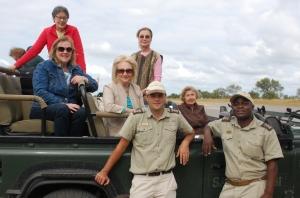 Participants in NPC African trip enjoy a safari. Back: Diane Wood, Mimi Higgins (NPC member), Mary Tully. Middle: Kathie Scarrah (NPC), Fay Iudicello (NPC). Front: Guides