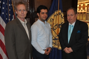Al Jazeera reporter Abdullah Elshamy (center) with NPC president Myron Belkind (right) and John M. Donnelly, chair of the NPC Freedom of the Press Committee (left).