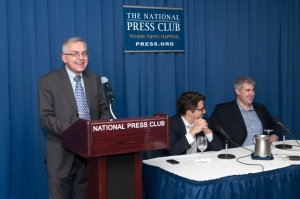 NPC's Book & Author Committee member Joe Luchock introduces Pulitzer Prize-winning journalists Adam Goldman (left) and Matt Apuzzo of the Associated Press before they discuss their book, <em>Enemies Within: Inside the NYPD's Secret Spying Unit and bin Laden's Final Plot Against America</em> at a National Press Club Book Rap, Sept. 10, 2013.