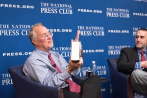 Pulitzer-prize winning historian David J. Garrow hefts his 1,400-page biography of former President Barack Obama while immediate-past National Press Club President Thomas Burr looks on during a Club Book Rap on May 11, 2017.