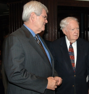 Newt Gingrich, former speaker of the House of Representatives and a Republican congressman from Georgia, left,  talks with 1961 NPC President John Cosgrove before Gingrich's National Press Club Luncheon speech on Aug. 19, 2005