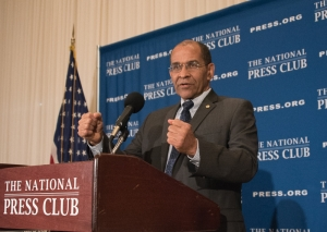 Christopher Hart, chairman of the National Transportation Safety Board Chairman holds an imaginary steering wheel as he answers a question about autonomous vehicles during his luncheon appearance at the National Press Club, June 30, 2016.