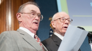 National Press Club Past Presidents David Hess and Don Larrabee lead the singing as The Owls induct new members during the Spring Hoot, April 26, 2012.