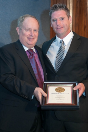 Reporter Joe Hosey accepts the John Aubuchon Press Freedom Award from NPC President Myron Belkind.