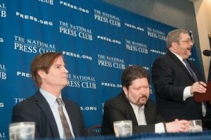 Paul Starrett, left, and Conor R. Crowley listen to Jason R. Baron