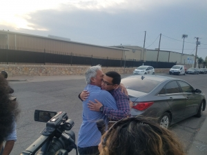 Mexican reporter Emilio Gutiérrez-Soto embraces his son Oscar after being released, July 26.