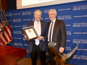 National Press Club Executive Director Bill McCarren receives Order of the Owl Award from member Frank Aukofer.