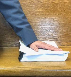 Emilio Gutiérrez-Soto's hand rests atop his case files as he awaits a hearing that his life may depend on.