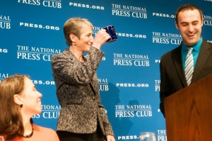 Interior Secretary Sally Jewell receives the traditional NPC Mug from Board of Governors Chair Thomas Burr at a National Press Club Luncheon, October 31, 2013.  Also pictured, Alison Fitzgerald, Speakers Committee Chair.