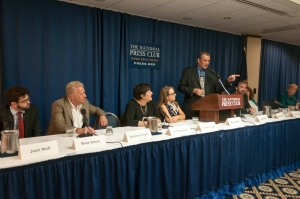 Brian Karem, standing, moderates a panel of journalists at a National Press Club Freedom of the Press event, June 1, 2015. The journalists all spent time in jail for doing their jobs. Panelists from left to right are Josh Wolf, Brad Stone, Lisa Abraham, Vanessa Leggett, Judith Miller (obscured) Brad Stone, Roxana Kopetman and Libby Averyt.