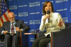 "Jean Case, chairman of the board of the National Geographic Society and author of ""Be Fearless,"" answers a question at a National Press Club Headliners Book Rap on Feb. 27. Club Vice President Mike Freedman moderated the event."