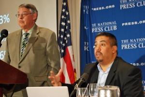 Juan González, left, and Joseph Torres speak at NPC book event