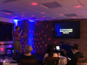 Young Member Robert King, healthcare reporter for the Washington Examiner, belts out song during Karaoke Night in the National Press Club's Cosgrove Lounge on Aug. 17, 2017.