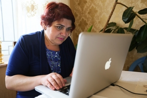 Journalist Khadija Ismayilova sits at a laptop computer as she inspects the page of Panama Papers.