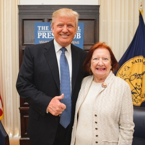 Marilou Donahue greets Donald Trump before the National Press Club luncheon on May 27, 2014.