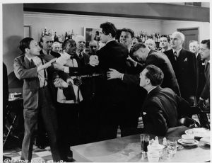 A still photo of the scene in which Jimmy Stewart rages in the National Press Club's taproom.
