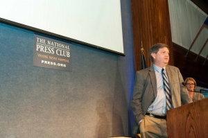 New York Times reporter James Risen accepts the John Aubuchon Domestic Freedom of the Press Award on behalf of this year's winner, The Whistleblower, August 6, 2013.  Also pictured, Angela Greiling Keane, NPC President.