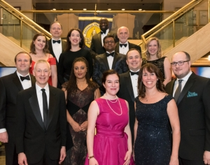 The National Press Club Board of Governors were among the approximately 220 attendees at the Feb. 10 inauguration of Club President Andrea Edney (front row, center, fuchsia dress). (l-r) Front row: Andy Fisher, Alison Fitzgerald Kodjak; Second row: Erik Meltzer, Kimberly Adams, Pat Host, Derek Wallbank; Third row: Jen Judson, Molly McCluskey, Ferdous Al-Faruque, Lindsay Murphy; Fourth row: Peter Urban, Jeff Ballou (ex-offfico), Michael Freedman. Not pictured: Michele Salcedo, Ed Barks.