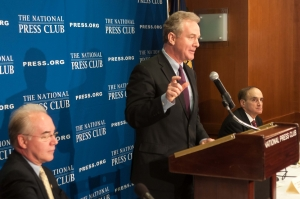 Rep. Chris Van Hollen, D-Md., ranking member of the House Budget Committee, speaks at a National Press Club Newsmakers event on Feb. 12, as Rep. Tom Price, R-Ga., left, and Bob Weiner, Newsmakers Committee member who organized the news conference, right, look on.