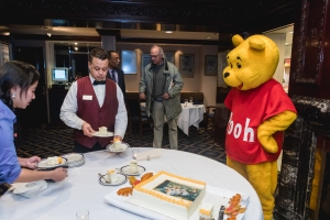 Winnie the Pooh supervises the serving of a Christopher Robbin cake at a Jan. 18 National Press Club Kids Night to celebrate A.A. Milne's birthday.