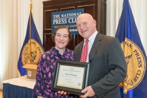 Kevin Wensing, a member of the National Press Club Headliners Team, won the 2018 Berny Krug Award as the Club's top volunteer. Club President Andrea Edney presided over the Club Vivian Awards Dec. 21.