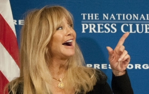 Actress Goldie Hawn laughs as she listens to National Press Club President Angela Greiling Keane introduce her before her luncheon speech Nov. 5..